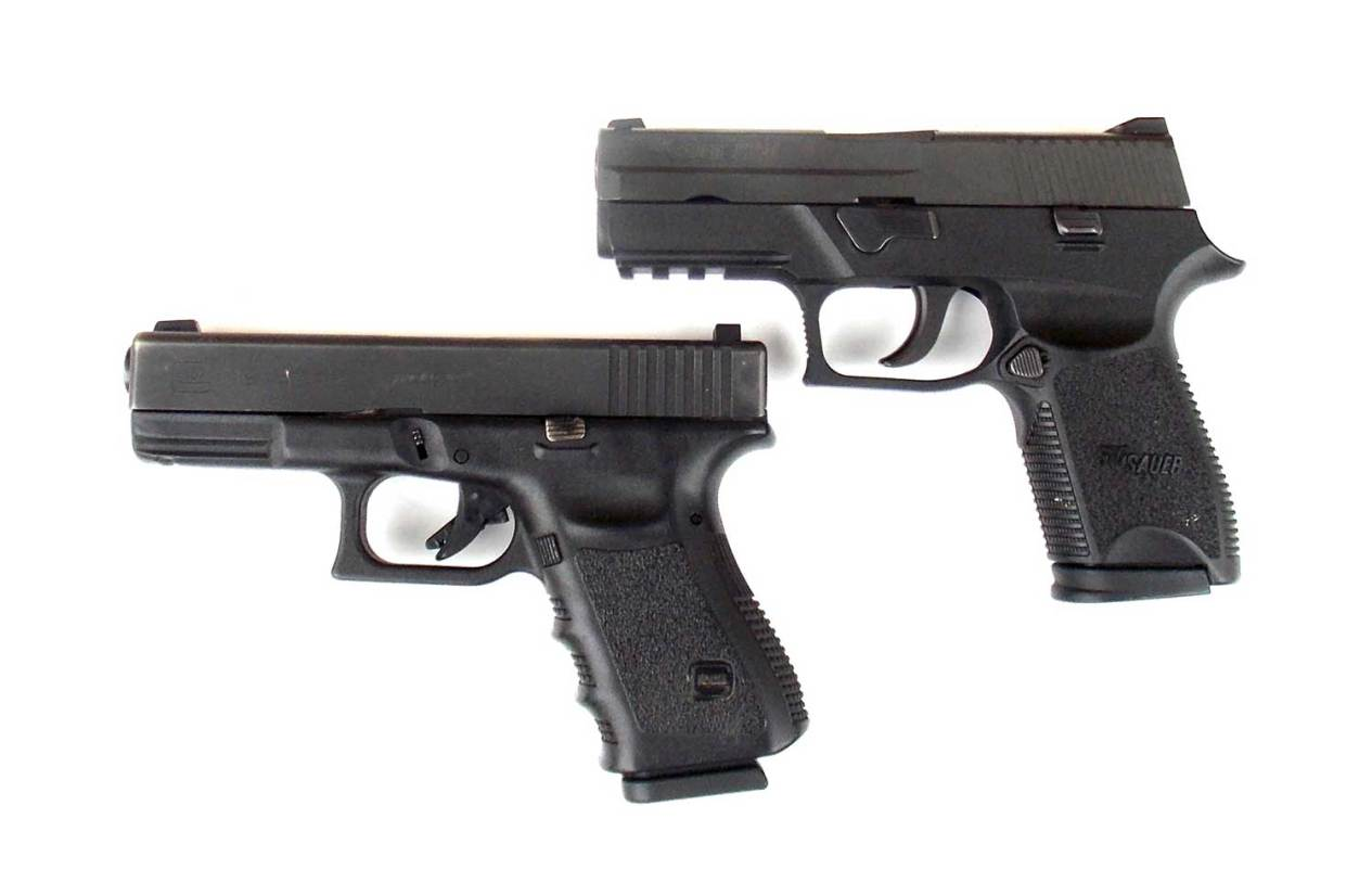 SIG Sauer and Glock pistols