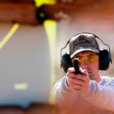 Target's view of man firing a pistol