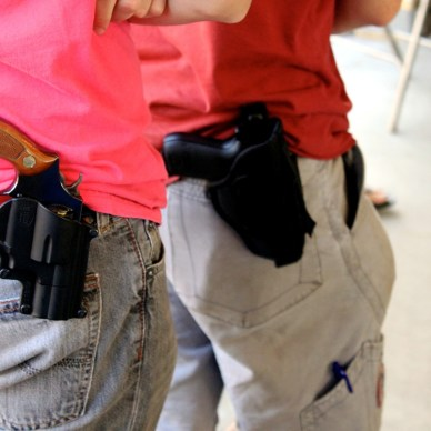 Two men carrying firearms openly on thier hip