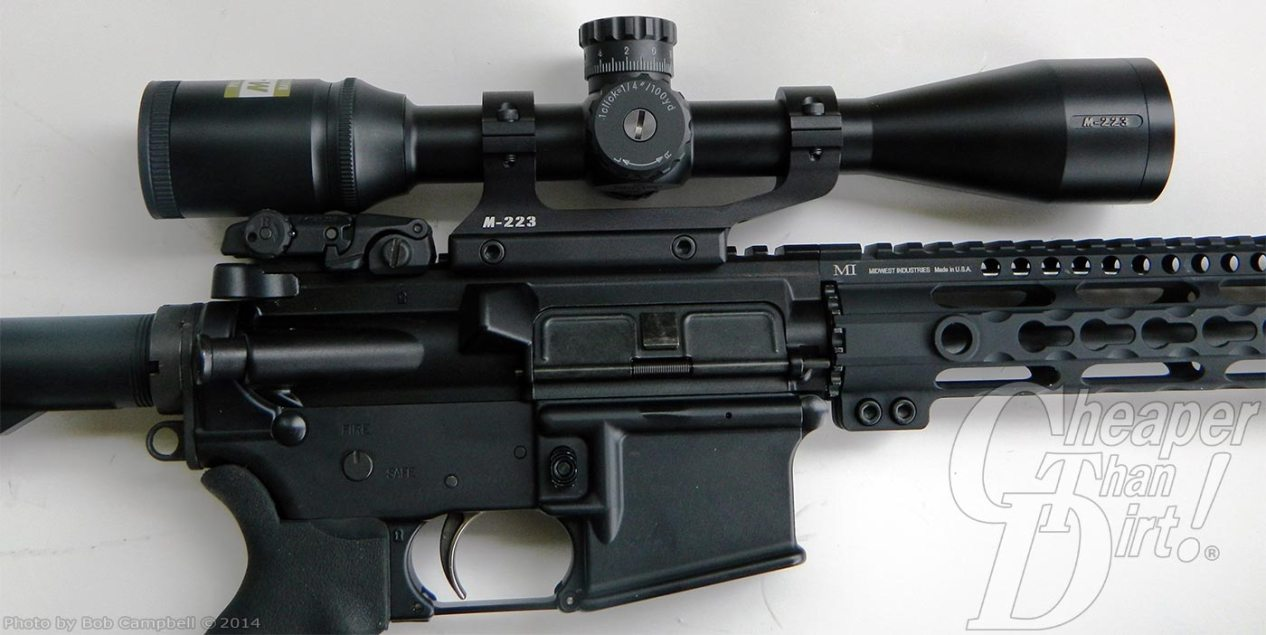 Black AR-15 and Nikon Riflescope on a gray-to-white background