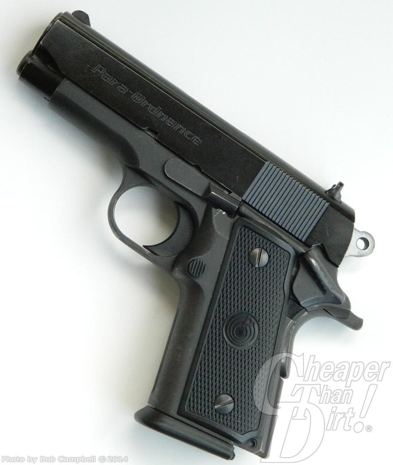 A black P12 with the barrel pointed up and to the left on a light gray-to-white background.