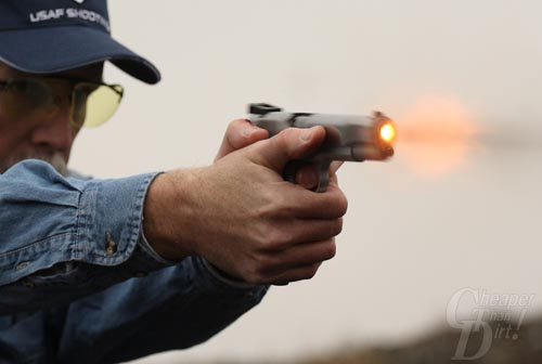 Patrick Kelley practicing with a pistol.