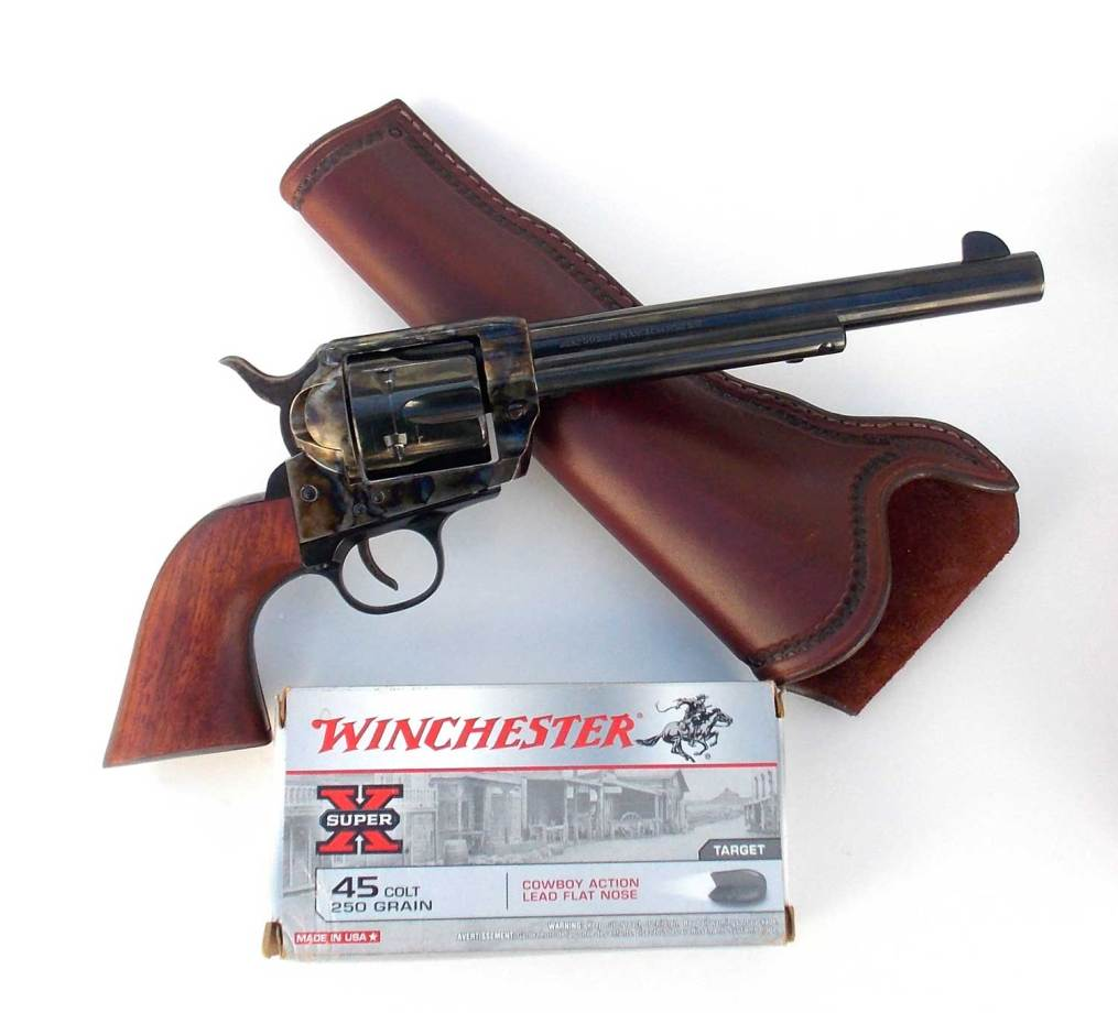 Traditions revolver laying on holster with a box of Winchester ammunition