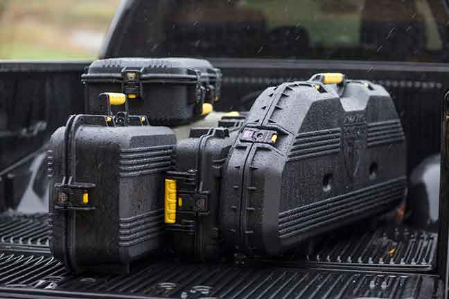 Plano's All-Weather Gun Guard cases in back of pickup truck