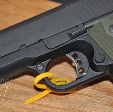 """Picture shows a close-up of a black polymer-framed 1911 stamped """"MODEL 1911-A1"""""""