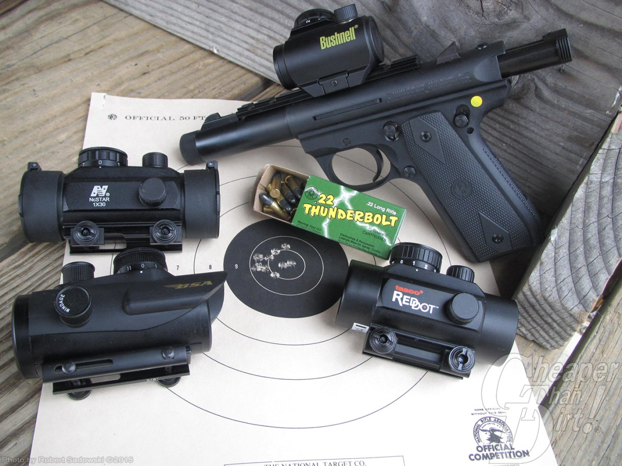 Red dot sights on a shooting target with a Ruger rimfire pistol