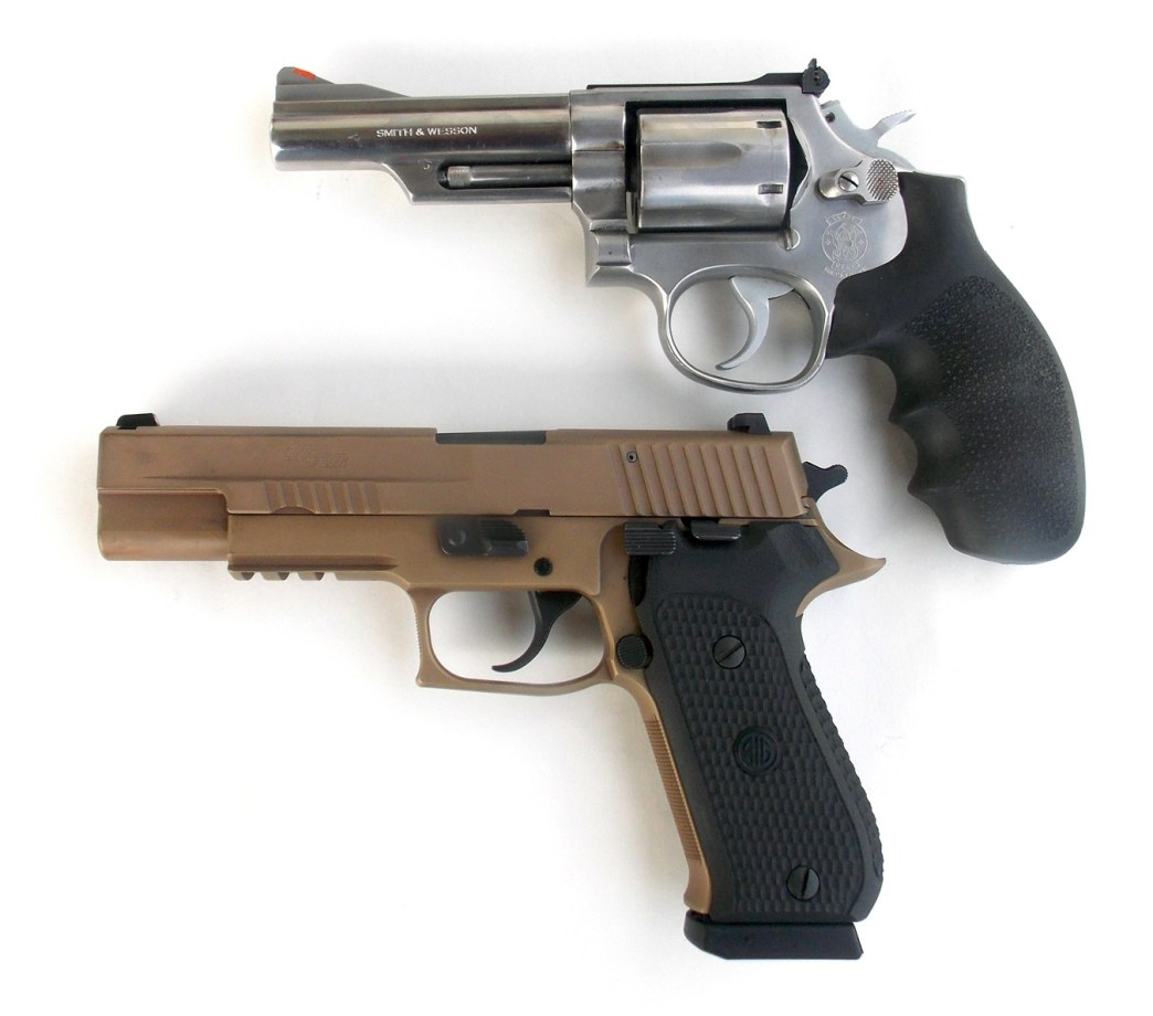 Chrome revolver top and SIG Sauer Emperor Scorpion bottom