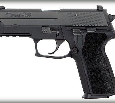 Late Model P229 with Modern Light Rail for attaching a combat light on a white background, barrel pointed to the left.