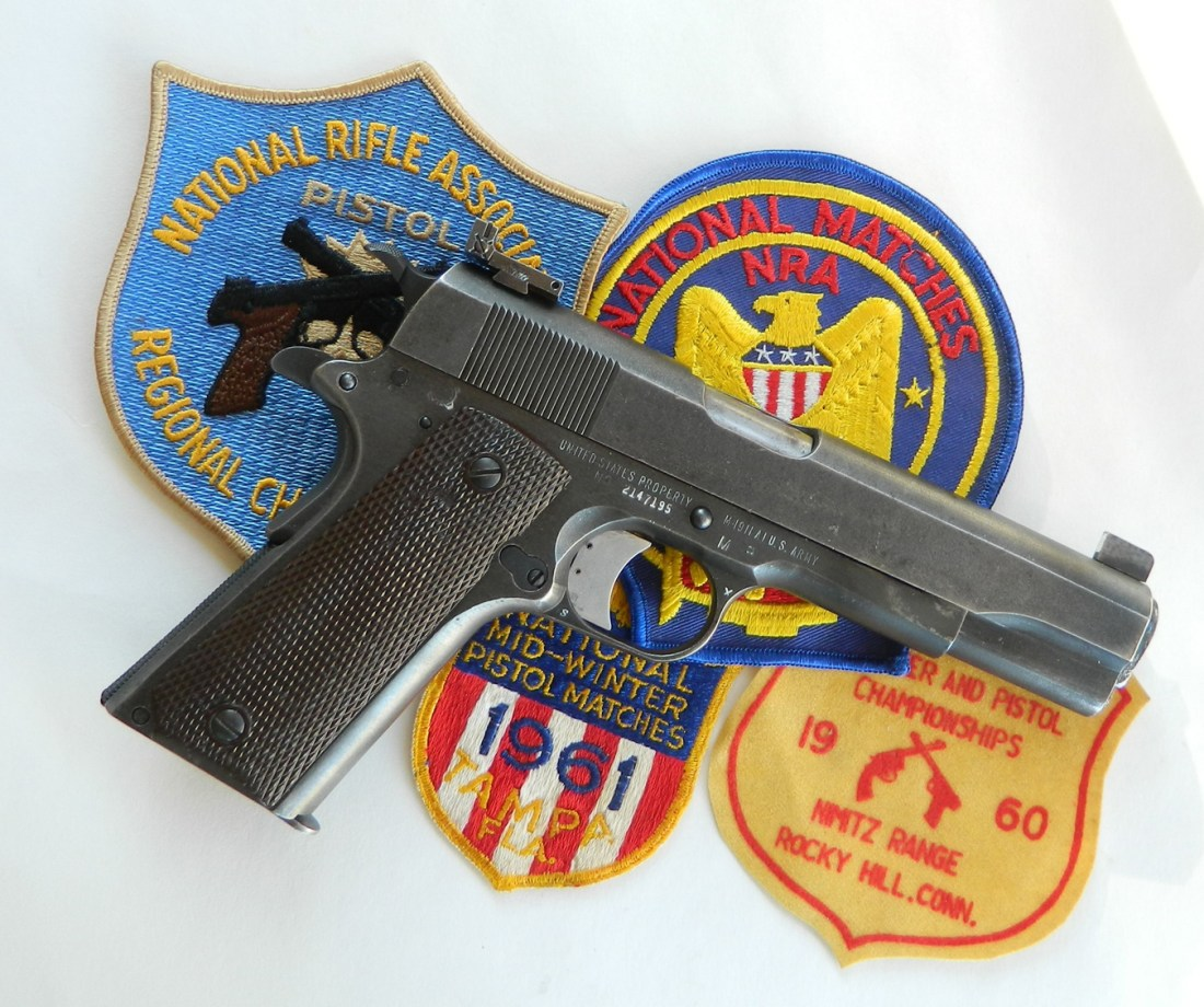 1911 pistol on top of several shooting patches
