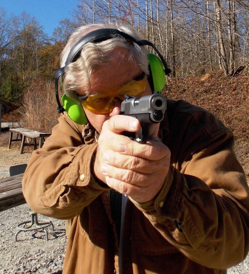 Bob Campbell aiming the Springfield EMP pistol