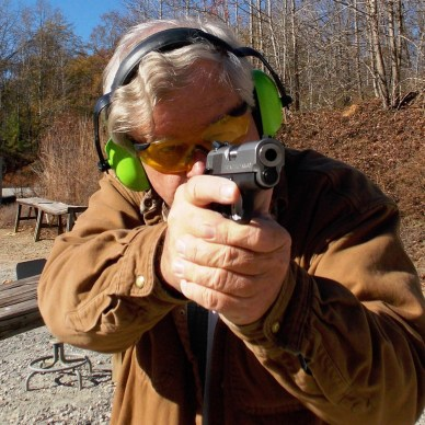 Bob Campbell aiming the Springfield EMP pistol