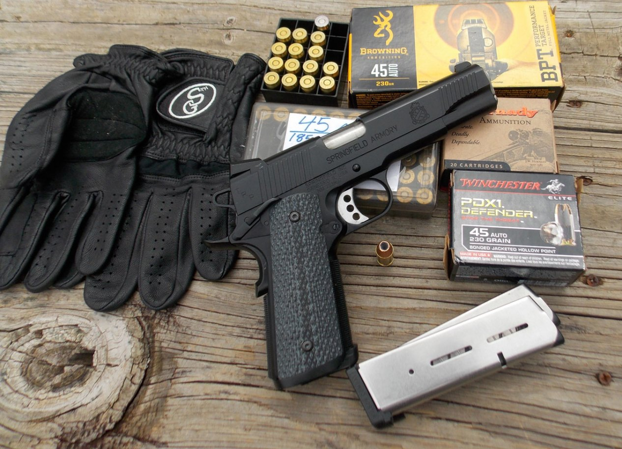Springfield TRP pistol, black with several boxes of ammunition