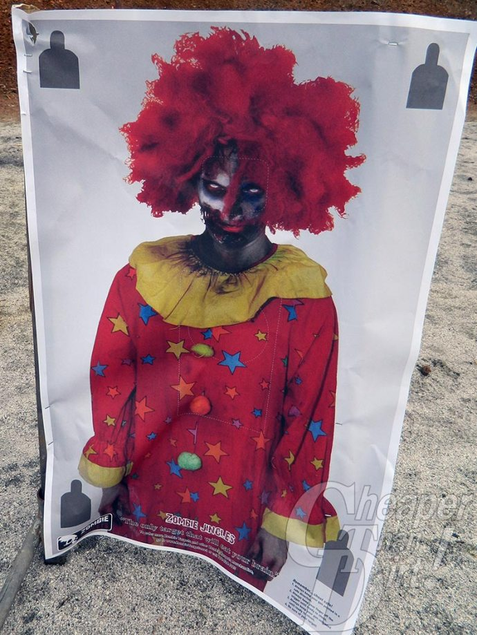 Zombie target with red-haired clown in red/yellow costume