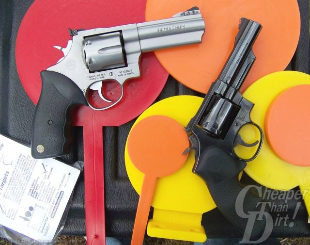 44 Magnum on left side, barrel pointed to the right, with black grip against orange and yellow shapes. There is a .357 Magnum on the right with a black grip, barrel pointed upward.
