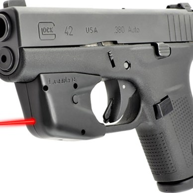 Picture shows a trigger guard laser sight on a GLOCK 42 pistol.
