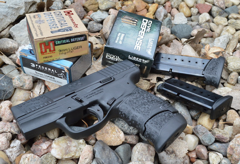 Walther PPS M2 pistol with boxes of Hornady Critical Defense and Civil Defense ammunition