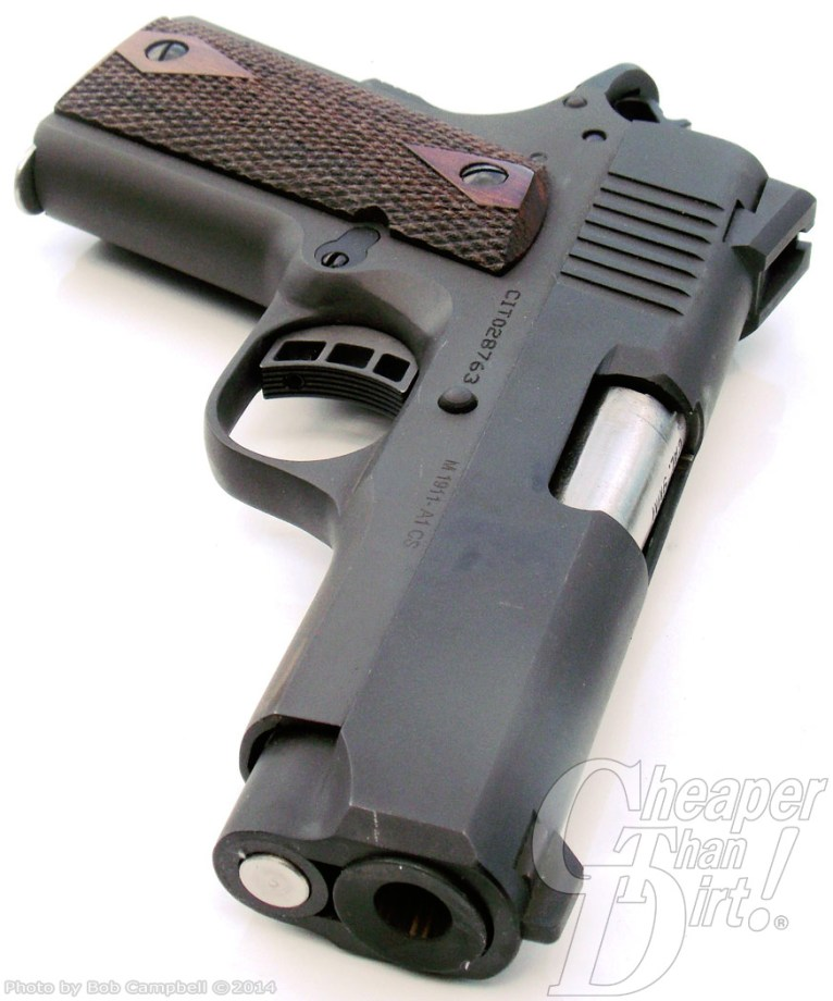 Brown grip, black barreled Citadel 9mm, barrel pointed down on a white background