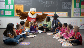 Eddie Eagle with a group of young students