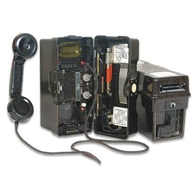 Photo shows two German military field phones, encased in a OD green Bakelite case.