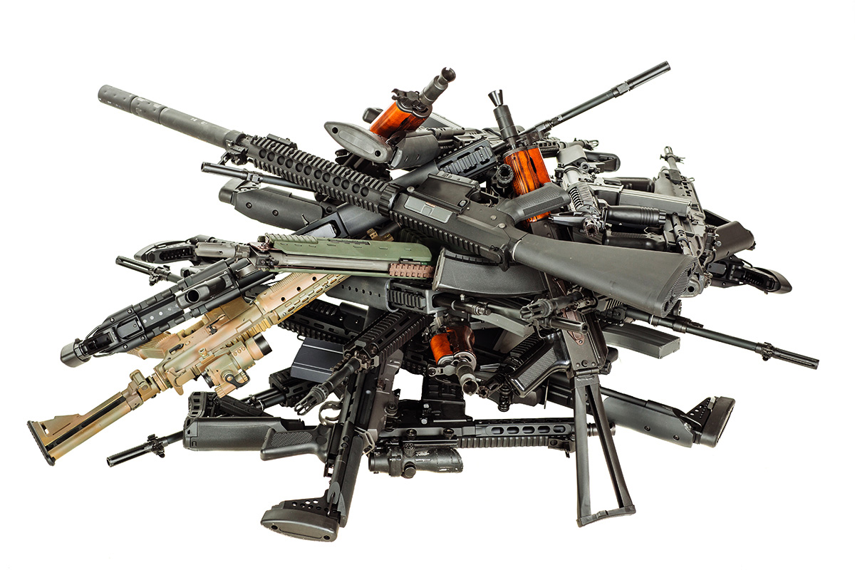 dozens of rifles in a pile