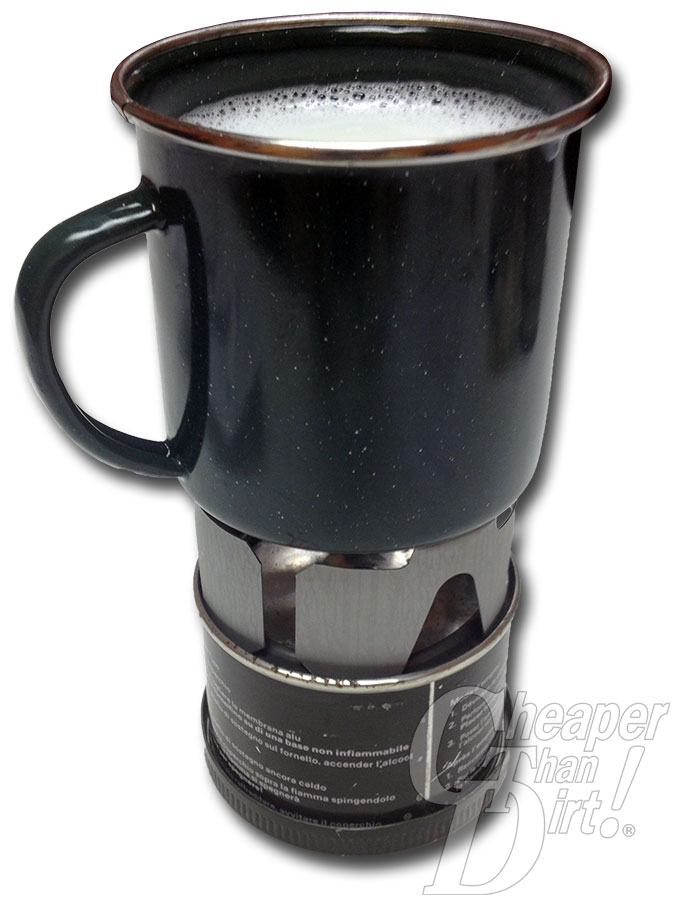 Picture shows a camp cup full of milk on a camp stove.