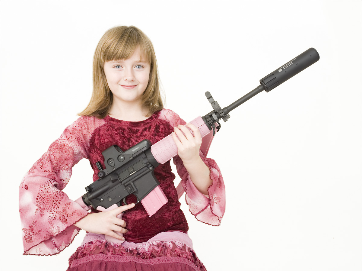 Child actress Morrigan Sanders has been shooting her pink M4 carbine since age 9.
