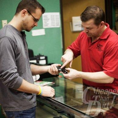 Customer at Cheaper Than Dirt making a legal gun purchase.