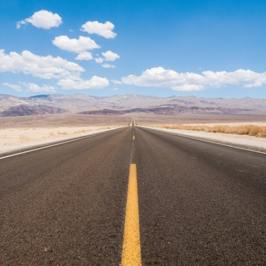 Long, straight open road in the desert