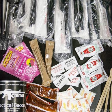 Picture shows the author's stash of free plastic ware and condiments from fast food places.