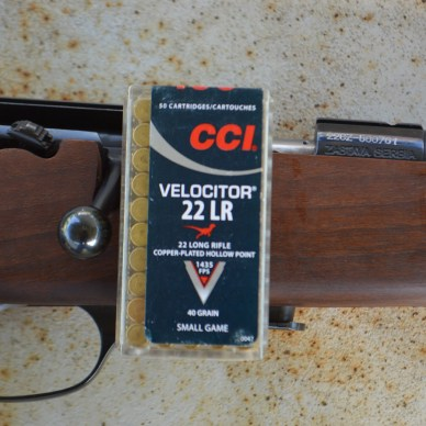 CCI .22 LR Velocitor ammunition box with bolt action rifle, .22 LR Defense