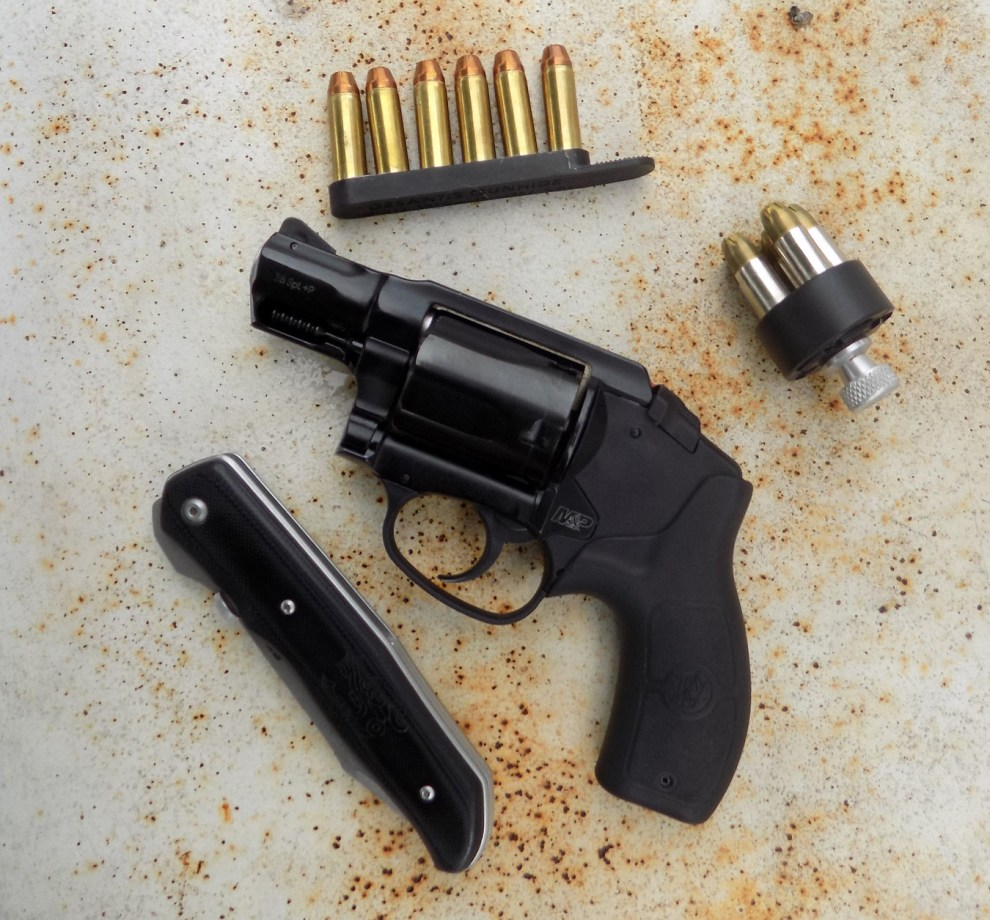 Snubnose revolver with pocket knife, and speedloaders