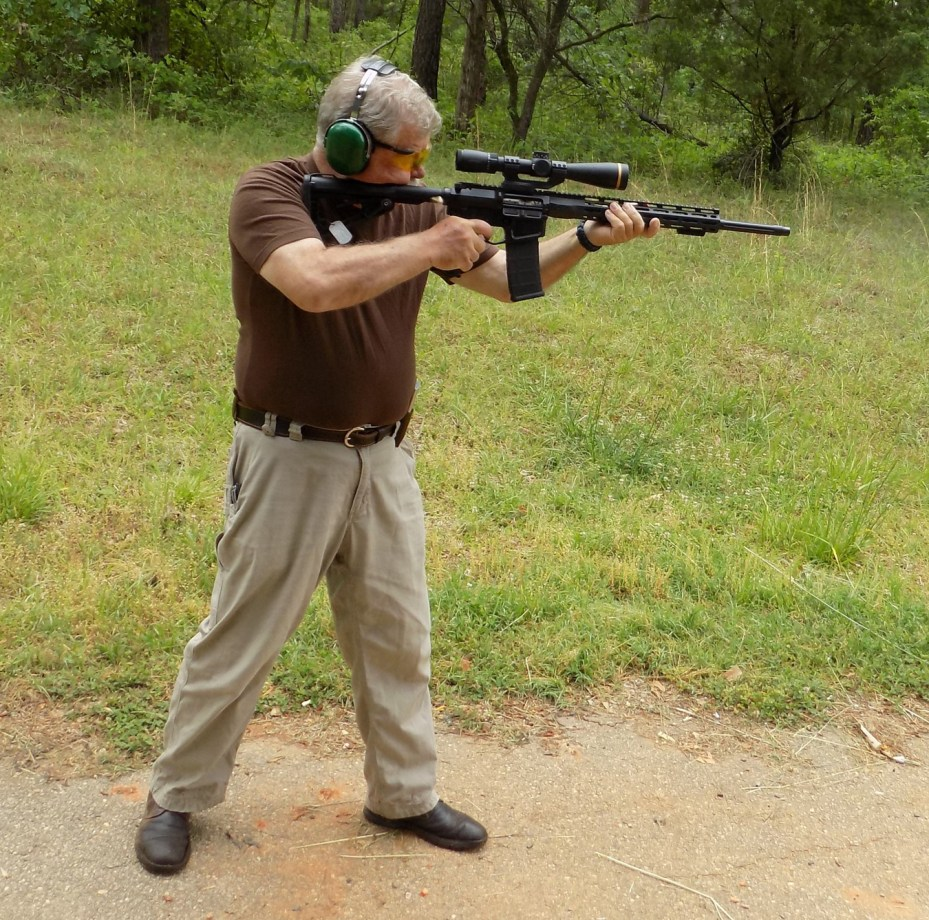 Bob Campbell shooting an Ar-15 rifle with a rifle scope