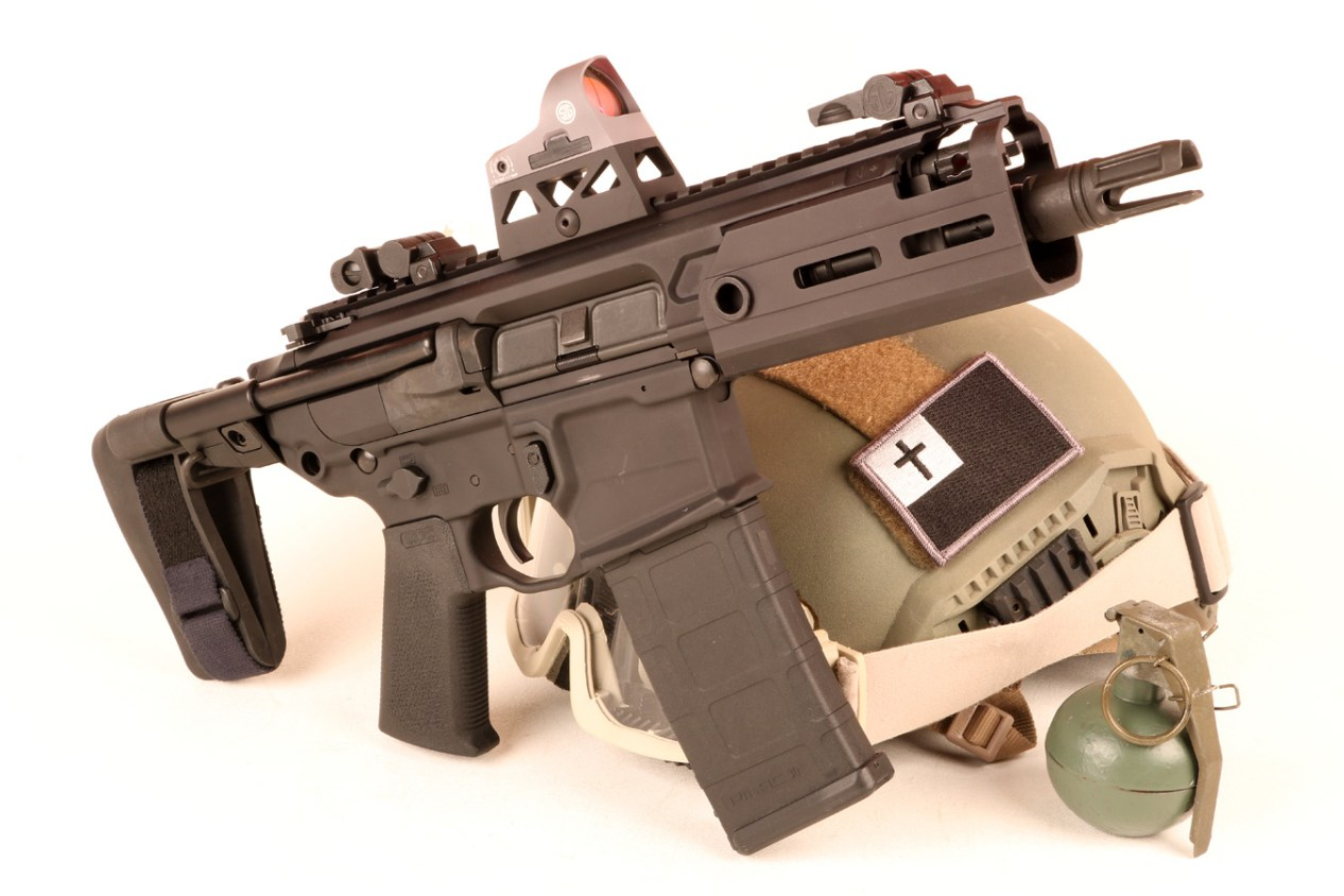 SIG MCX Rattler with bump helmet in the background