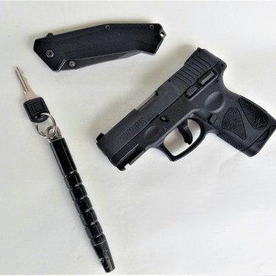 Taurus G2S Millennium with pocket knife and kubotan