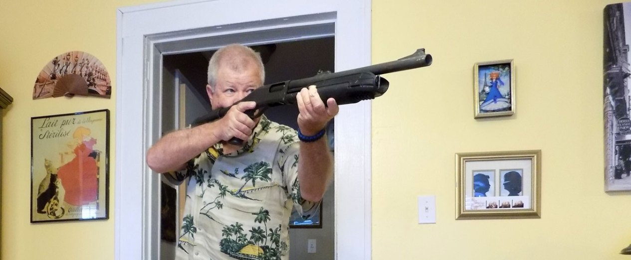 Bob Campbell defending the home with a shotgun