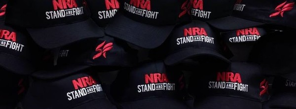 Pile of NRA Stand and Fight hats
