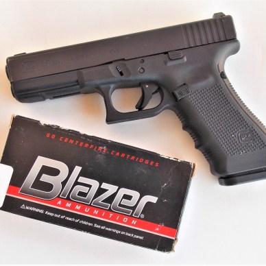 Blazer 9mm ammunition box with Glock pistol