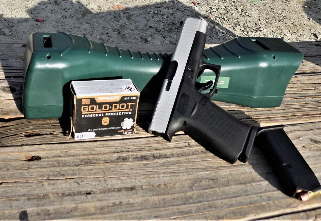 GLOCK 48 pistol two-tone with Gold Dot ammunition box