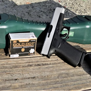 GLOCK 48 pistol two-tone with Gold Dot ammunition box