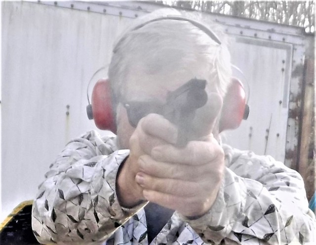 Bob Campbell shooting the Browning Buckmark pistol with a two handed grip