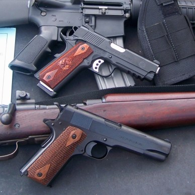 two handguns with old and new rifle