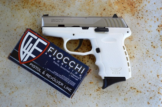 White SCCY CPX-2 left profile with a box of Fiocchi ammunition