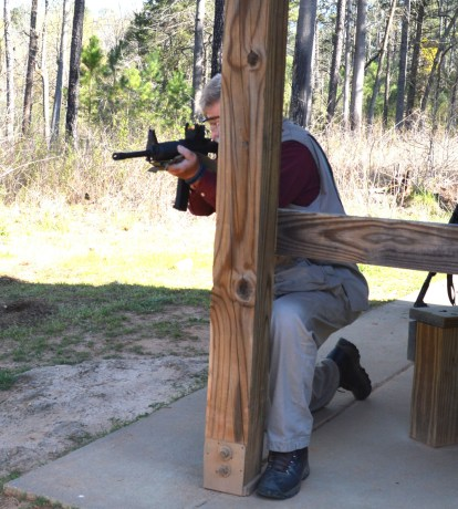 Bob Campbell shooting an AR-15 from a kneeling postition