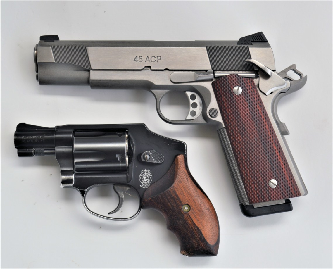 Colt 1911 pistol with a snubnose revolver for concealed carry