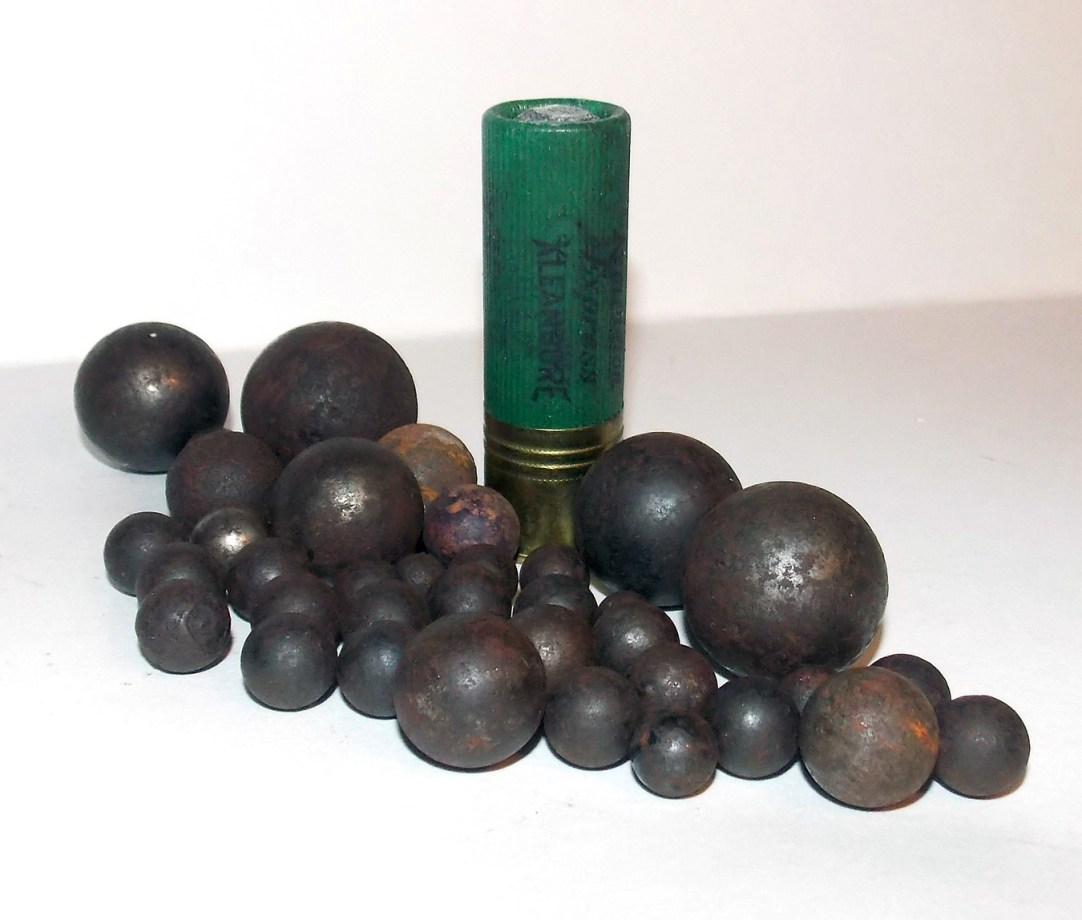 Shotgun shell with several slugs and ball ammunition