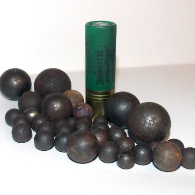 Shotgun shell with several shotgun slug and ball ammunition