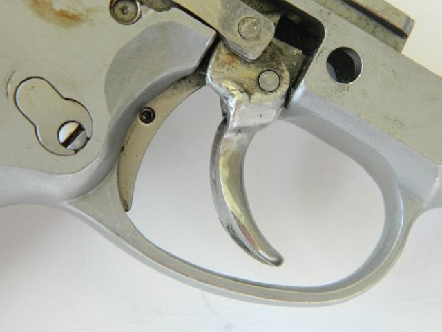 broken pistol trigger that has been welded