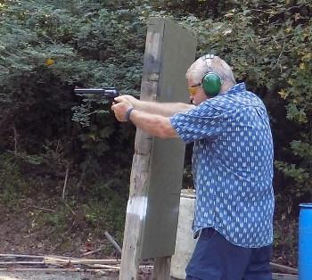 Bob Campbell shoting a revolver at an outdoor range