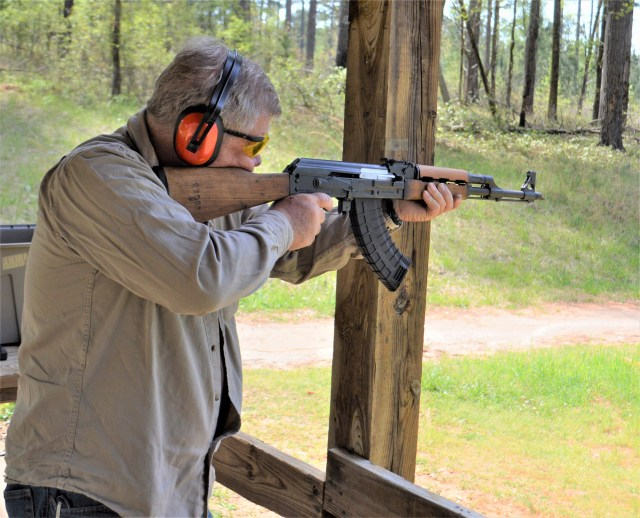 AK rifle loads in action
