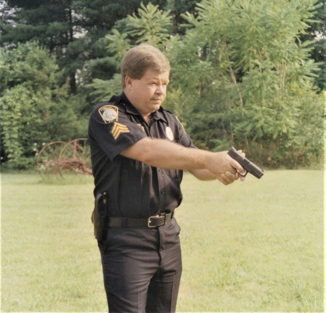 Peace officer ready to shoot.
